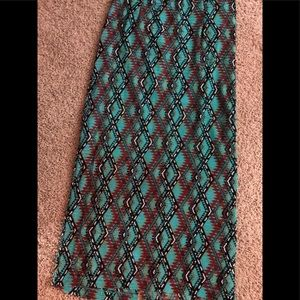 Long straight geometric turquoise lined skirt